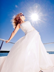 Bridal portrait on a boat in the bright sun